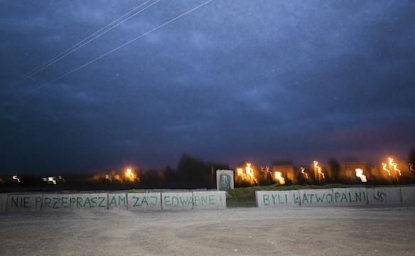 A view of a monument in Jedwabne with Nazi swastikas painted over it