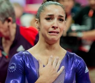 Raisman, overcome with emotion and the sounds of Hava Nagila, at Olympics (Credit: AP)
