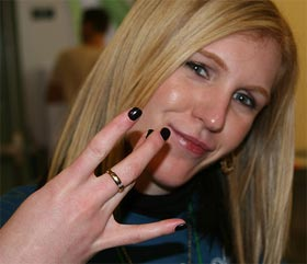 Jewlicious student volunteer Goldie flashing her West Side gang hand signal. It's an LA thing, don't worry...