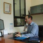 Michael Dickson at his desk