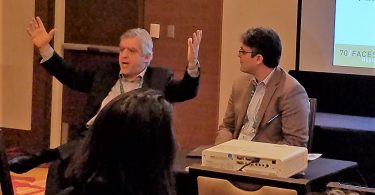 David Suissa speaking alongside Leo Lazar